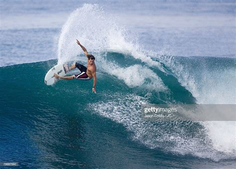 Three-times World Champion Andy Irons of the USA performs
